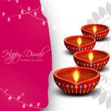 Tarjeta de felicitación con las lámparas de aceite para Diwali feliz Fotografía de archivo libre de regalías