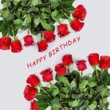 Tarjeta de felicitación con las rosas rojas Fotografía de archivo