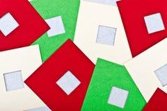 Tarjeta de felicitación con los cuadrados coloreados Imagen de archivo
