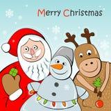Tarjeta de felicitación con Papá Noel, el reno y el muñeco de nieve Imagen de archivo