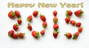 Tarjeta de felicitación de la Feliz Año Nuevo 2015 Figuras de las fresas Imagen de archivo
