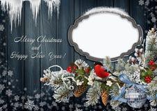 Tarjeta de felicitación de la Navidad con el marco Imagen de archivo libre de regalías