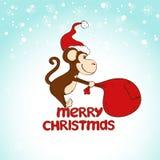 Tarjeta de felicitación de la Navidad con el mono que tira de un saco grande Imagen de archivo libre de regalías