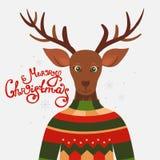 Tarjeta de felicitación de la Navidad con el reno Foto de archivo libre de regalías