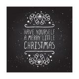Tarjeta de felicitación de la Navidad con el texto en la pizarra Imagenes de archivo