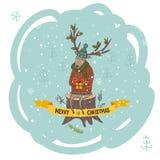 Tarjeta de felicitación de la Navidad con los ciervos y el regalo Foto de archivo libre de regalías