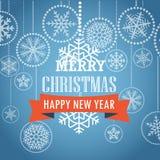 Tarjeta de felicitación de la Navidad con los copos de nieve en fondo Fotografía de archivo libre de regalías