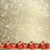 Tarjeta de felicitación de la Navidad con los presentes imágenes de archivo libres de regalías