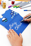 Tarjeta de felicitación de la Navidad de la escritura del niño Fotografía de archivo