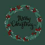 Tarjeta de felicitación de las letras de la mano de la Feliz Navidad Foto de archivo