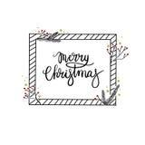 Tarjeta de felicitación de las letras de la mano de la Feliz Navidad Caligrafía moderna Fotografía de archivo