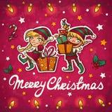 Tarjeta de felicitación de los elfs de la Navidad Fotografía de archivo libre de regalías