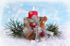 Tarjeta de felicitación del Año Nuevo con una vela y las ramas Fotos de archivo libres de regalías