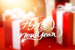 Tarjeta de felicitación del Año Nuevo, fondo borroso en la celebración de la caja de regalo Imagenes de archivo