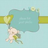 Tarjeta de felicitación del bebé con el marco de la foto Fotografía de archivo