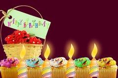 Tarjeta de felicitación del cumpleaños con la magdalena y la vela Fotografía de archivo