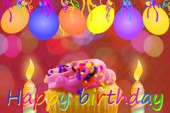 Tarjeta de felicitación del cumpleaños con la tira y las velas del globo de la magdalena Foto de archivo