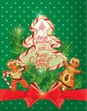 Tarjeta de felicitación del día de fiesta con el pan de jengibre de Navidad Imagen de archivo libre de regalías