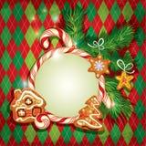 Tarjeta de felicitación del día de fiesta del Año Nuevo con el pan de jengibre de Navidad Imagenes de archivo