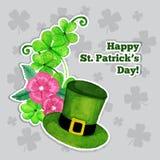Tarjeta de felicitación del día de Stpatrick con el sombrero, flores y Imagen de archivo