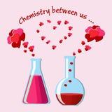 Tarjeta de felicitación del día del ` s de la tarjeta del día de San Valentín con dos frascos químicos con las pociones de amor y Fotografía de archivo