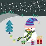 Tarjeta de felicitación del muñeco de nieve y del árbol de navidad Imagen de archivo