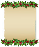 Tarjeta de felicitación del papel del acebo de la Navidad Fotos de archivo