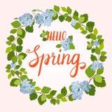 Tarjeta de felicitación hermosa con una guirnalda de las flores y de las letras azules de la primavera Foto de archivo libre de regalías