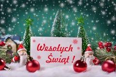 Tarjeta de felicitación de la Navidad con Feliz Navidad del texto rojo en pulimento Fotos de archivo libres de regalías