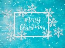 Tarjeta de felicitación de la Navidad con los copos de nieve Imagen de archivo