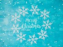 Tarjeta de felicitación de la Navidad con los copos de nieve Fotografía de archivo