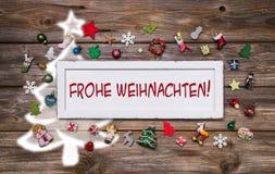 Tarjeta de felicitación para la Navidad con el texto alemán para la Feliz Navidad Foto de archivo libre de regalías