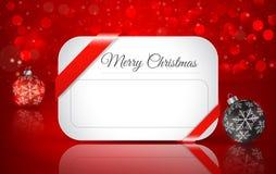 Tarjeta de felicitación para la Navidad con la bola de la Navidad Imagen de archivo
