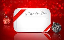 Tarjeta de felicitación por Feliz Año Nuevo con la bola de la Navidad el invierno b Fotos de archivo libres de regalías