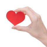 Tarjeta de felicitación roja en forma de corazón en la mano de la muchacha Fotografía de archivo