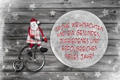 Tarjeta de felicitación alemana de la Navidad con feliz Navidad del texto y succes Imágenes de archivo libres de regalías