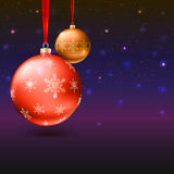 Tarjeta de felicitación con las bolas de la Navidad y el fondo brillante Fotografía de archivo libre de regalías