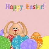 Tarjeta de felicitaciones de Pascua con el conejo y los huevos Fotografía de archivo libre de regalías