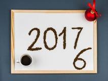 Tarjeta 2017 de felicitaciones del café de la Feliz Año Nuevo Imagen de archivo libre de regalías