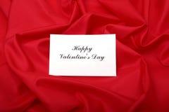 Tarjeta de felicitaciones en blanco en un fondo rojo Izquierdo vacie para que el diseñador añada su propio mensaje Fotos de archivo libres de regalías