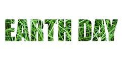 Tarjeta de la celebración del Día de la Tierra con la inscripción en hierba verde Foto de archivo