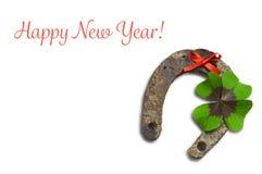 Tarjeta de la Feliz Año Nuevo con el trébol de herradura y afortunado aislado en blanco Imagenes de archivo