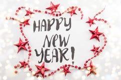 Tarjeta de la Feliz Año Nuevo con la decoración de la Navidad Imágenes de archivo libres de regalías