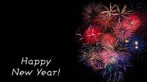 Tarjeta de la Feliz Año Nuevo con los fuegos artificiales foto de archivo