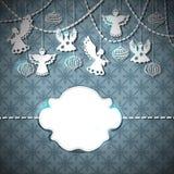 Tarjeta de la Feliz Navidad con ángeles y juguetes Imagen de archivo