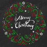 Tarjeta de la Feliz Navidad con colores clásicos de Navidad de la guirnalda colorida Foto de archivo libre de regalías
