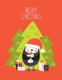 Tarjeta de la Feliz Navidad con el personaje de dibujos animados del pingüino con Cristo Imagen de archivo