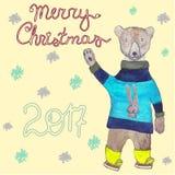 Tarjeta de la Feliz Navidad 2017 con un oso que patina en ropa Ilustración drenada mano Fotos de archivo
