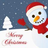 Tarjeta de la Feliz Navidad Nevado del muñeco de nieve Foto de archivo libre de regalías