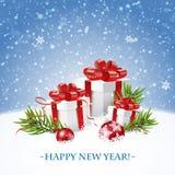 Tarjeta de la Feliz Navidad y de la Feliz Año Nuevo con la caja de regalo Fotografía de archivo libre de regalías